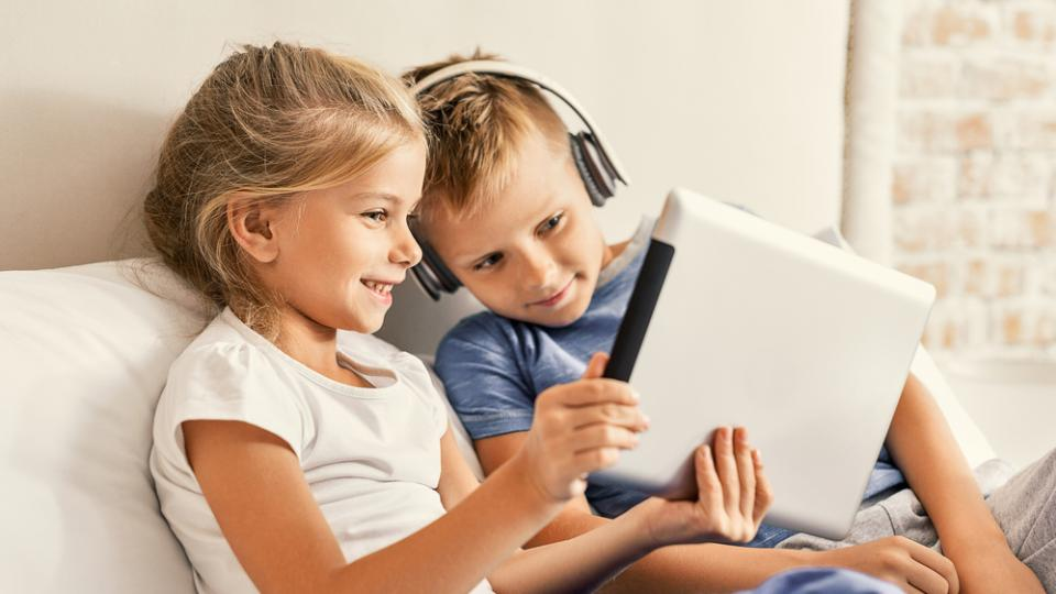 Daughter and Son distracted by online video content