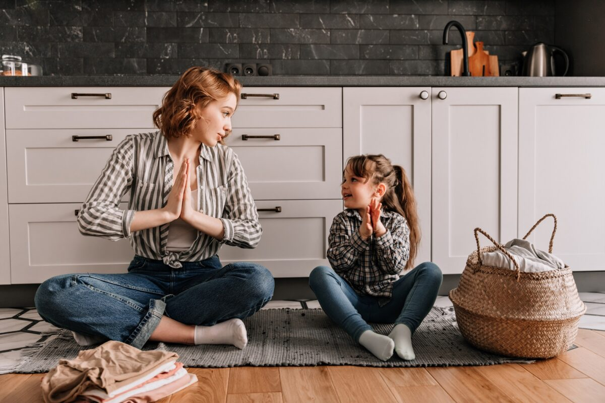 child teaching mom yoga