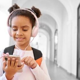 Child listening to podcast